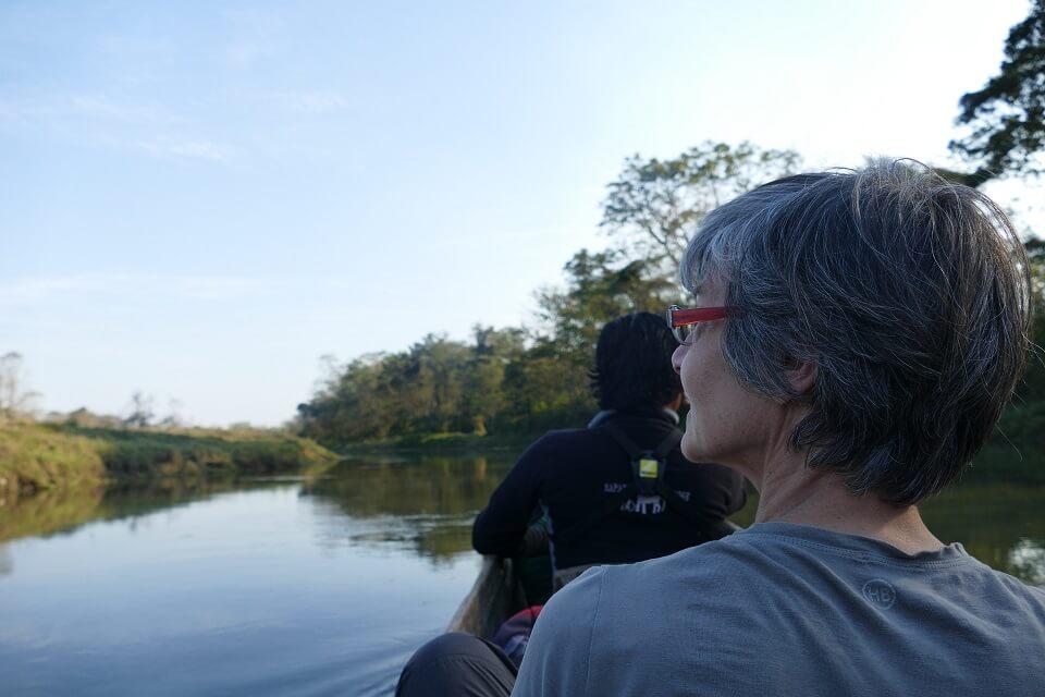Traveler on boat safari in Chitwan National Park