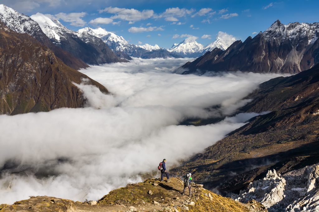 Trekker on the way to the valley covered with cloud on Manaslu c